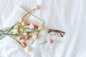 flowerson-beside-eyeglasses