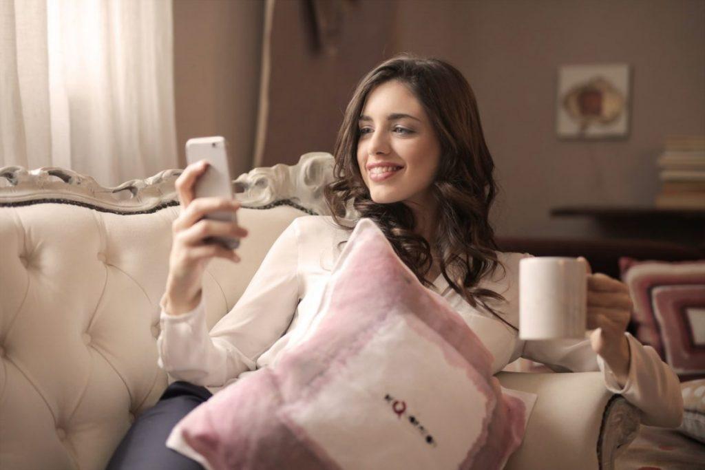 woman-holding-smartphone-sitting